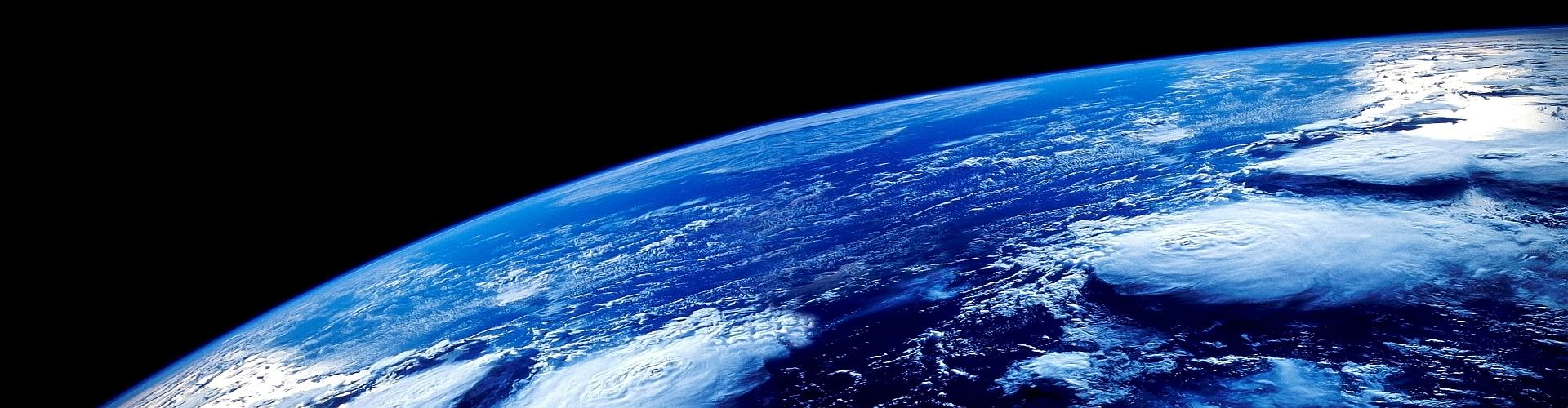 This is our home, planet Earth, where we live. Isn't she beautiful? See the hurricanes - they can be up to 1000 miles across.